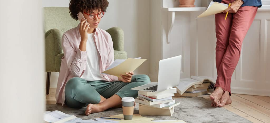 female business owner with scattered papers